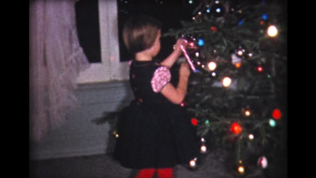 1960 kids hang candy canes on xmas tree - 1960 stock videos and b-roll footage