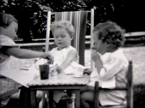 1933 kids have tea party in back yard - tea party stock videos and b-roll footage