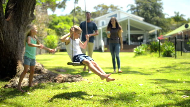 kids having fun at the garden - swinging stock videos & royalty-free footage