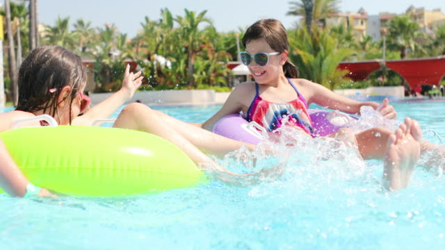 kids having fun in swimming pool - tourist resort stock videos and b-roll footage