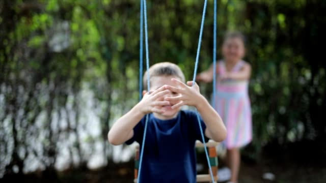 kids having fun on a swing - swinging stock videos & royalty-free footage