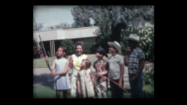 1967 kids holding american flag on the 4th of july - stars and stripes stock videos & royalty-free footage