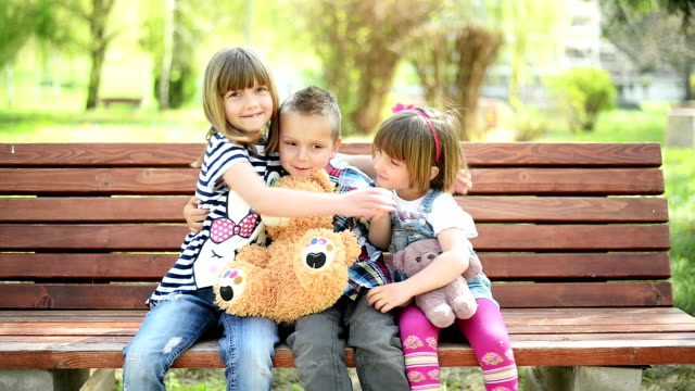 kids hugging - teddy bear stock videos and b-roll footage