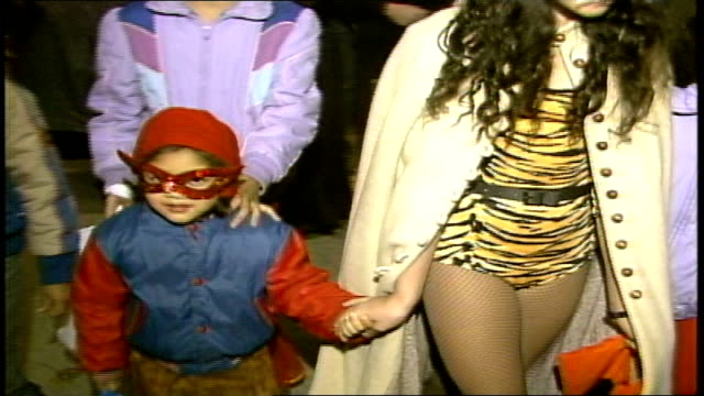 kids in halloween costumes walking past camera - 1985年点の映像素材/bロール