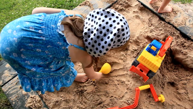 kids in sandbox 1080p - sand pit stock videos and b-roll footage