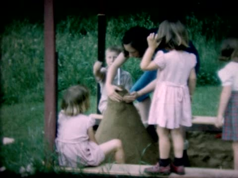 1947 kids in sandbox make large mound - sand pit stock videos and b-roll footage