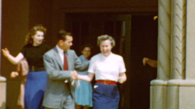 kids in school yard / teachers being friendly / children playing / line up / happy teachers at emerson school on october 03 1955 in burbank california - burbank stock-videos und b-roll-filmmaterial