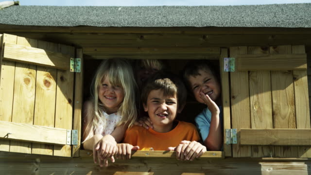 kids in tree house (shot on red) - treehouse stock videos & royalty-free footage