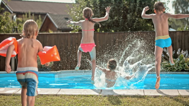 slo mo ds kids jumping into the pool - boundary stock videos & royalty-free footage