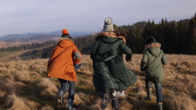 kids kids hiking in hills in winter - exhilaration stock videos & royalty-free footage