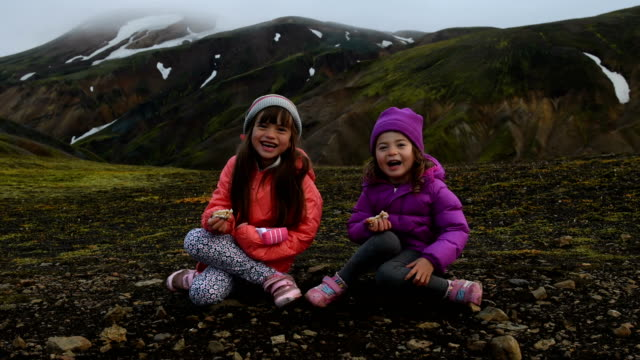 Kids laughing on a vacation in Landmannalaugar Iceland