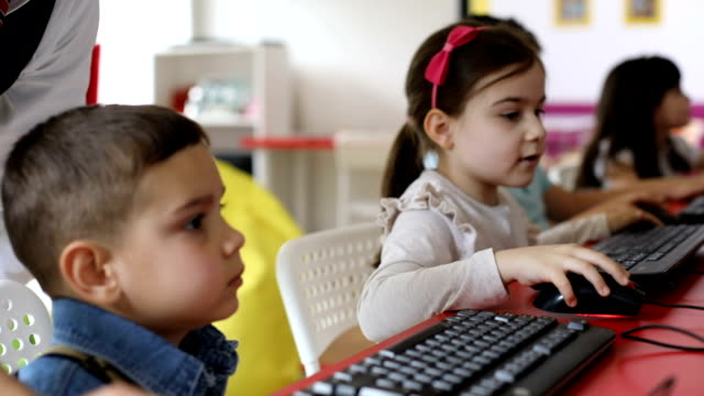 Kids learning to use computers