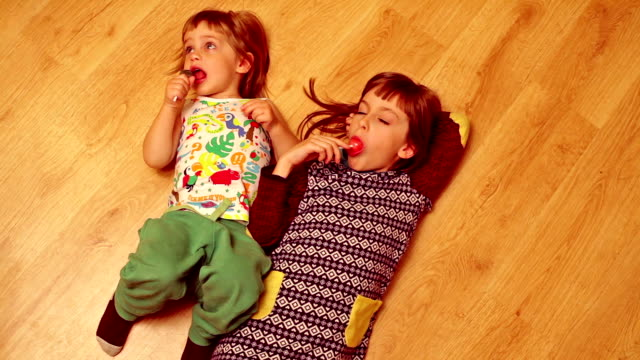 kids licking lollipops - lollipop stock videos and b-roll footage