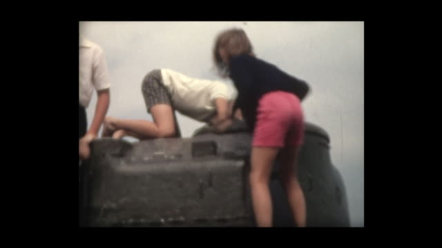 1967 kids looking at tanks at normandy memorial - military land vehicle stock videos & royalty-free footage