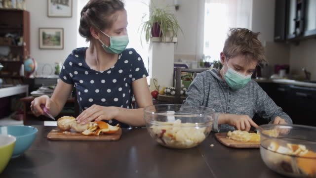 kids making fruit salad at home during covid-19 pandemic - fruit salad stock videos & royalty-free footage