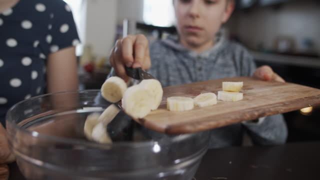 kids making fruit salad at home. - dessert stock videos & royalty-free footage