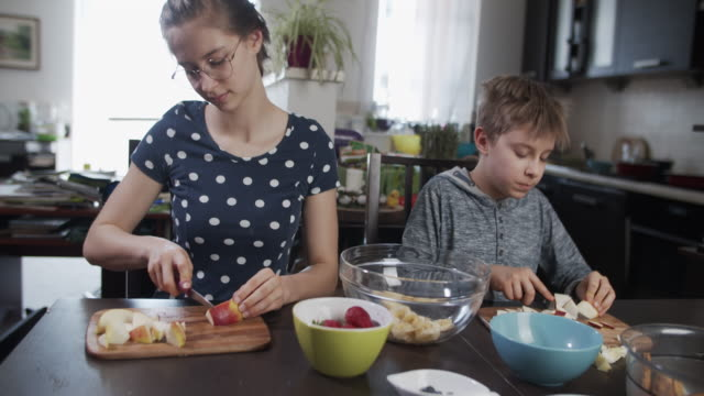 kids making fruit salad at home. - cutting stock videos & royalty-free footage