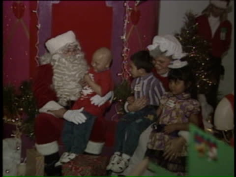wgn kids meeting santa and mrs claus on december 13 1992 in chicago illinois - mrs claus stock videos and b-roll footage
