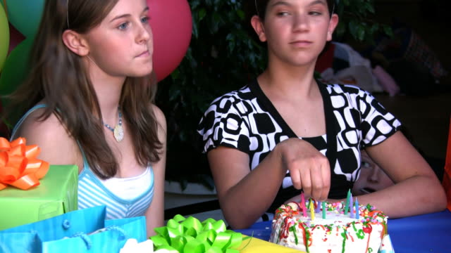 (hd1080i) kids misbehaving at birthday party - teenagers only bildbanksvideor och videomaterial från bakom kulisserna