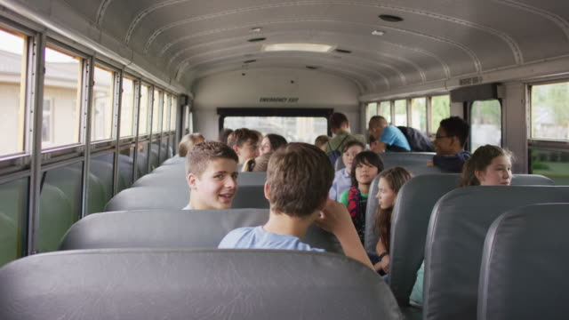 kids on a school bus - junior high stock videos & royalty-free footage