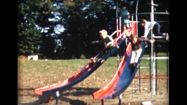 vídeos de stock, filmes e b-roll de 1961 kids on jungle gym - jungle gym