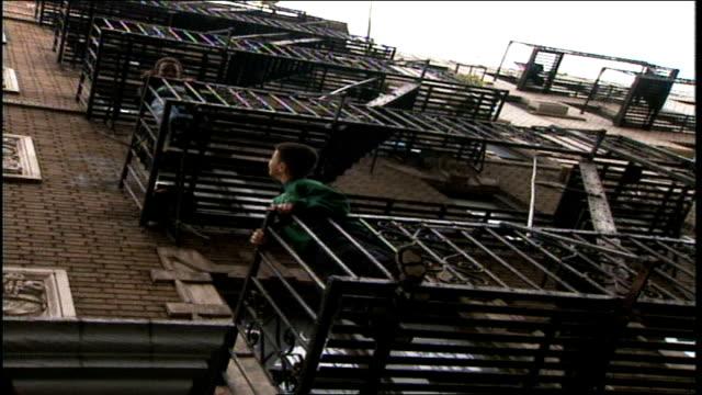 kids on nyc fire escape - 非常階段点の映像素材/bロール