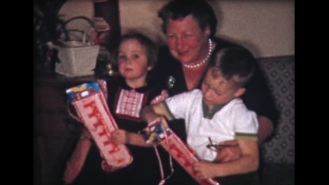 1960 kids open xmas present with grandma - home movie stock videos & royalty-free footage