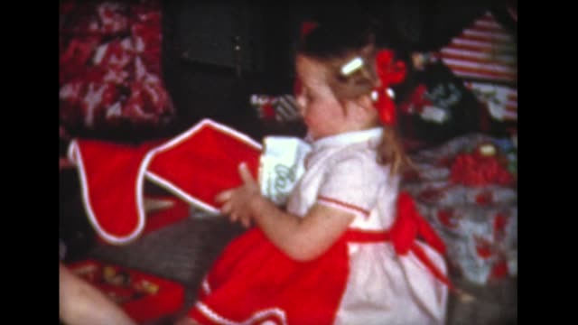 1959 kids open xmas stockings and presents - 1950 1959 stock videos & royalty-free footage