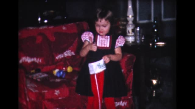 1960 kids open xmas stockings and presents - stockings stock videos & royalty-free footage