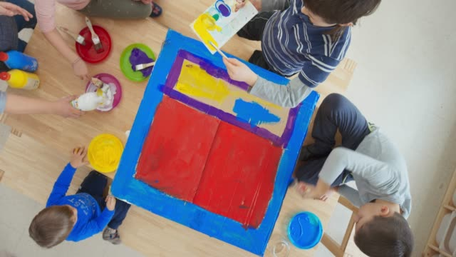 kids painting a carton box - preschool child stock videos & royalty-free footage