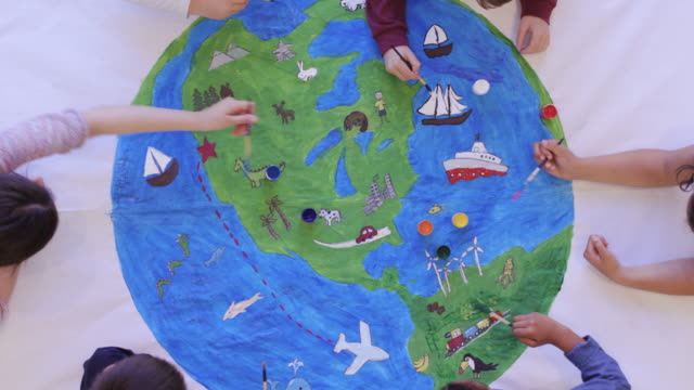 kids painting mural of the world - world population stock videos & royalty-free footage
