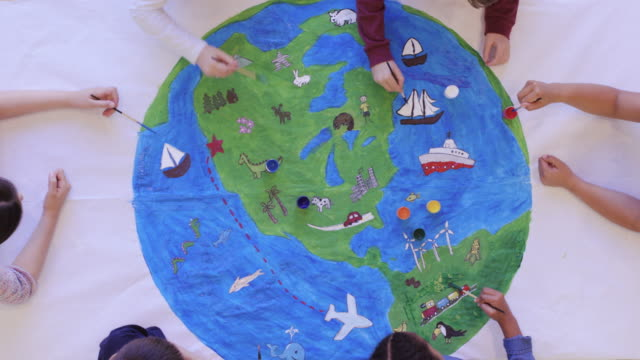 kids painting mural of the world - education stock videos & royalty-free footage