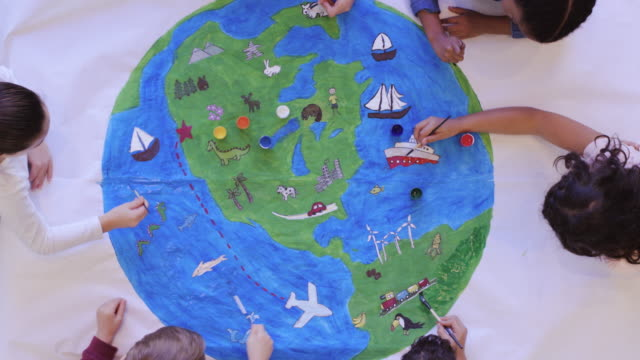 kids painting mural of the world - environmental conservation stock videos & royalty-free footage