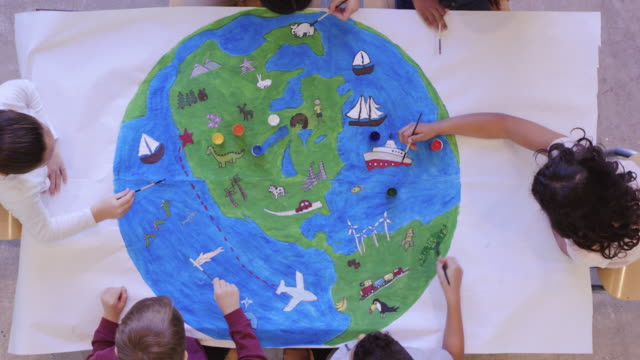 kids painting mural of the world - social issues stock videos & royalty-free footage