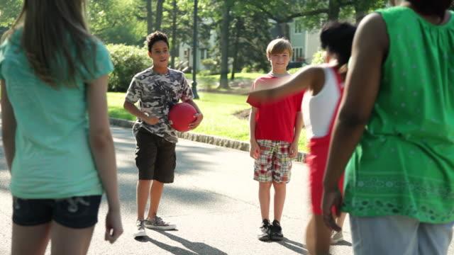 MS PAN Kids picking sides in kickball game / Summit, New Jersey, United States