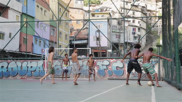 ms, pan kids play football in a favela / rio de janeiro, brazil - shirtless stock videos and b-roll footage