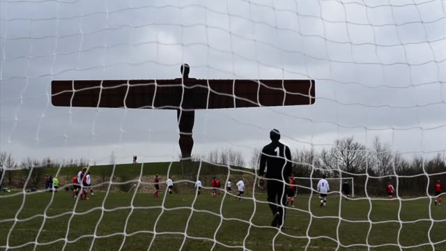 kids play football near the angel of the north general views of angel of the north on april 05 2013 in newcastle upon tyne england - angel of the north stock videos and b-roll footage