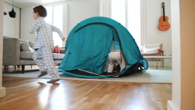 kids playing at home with a tent - pyjamas stock videos & royalty-free footage