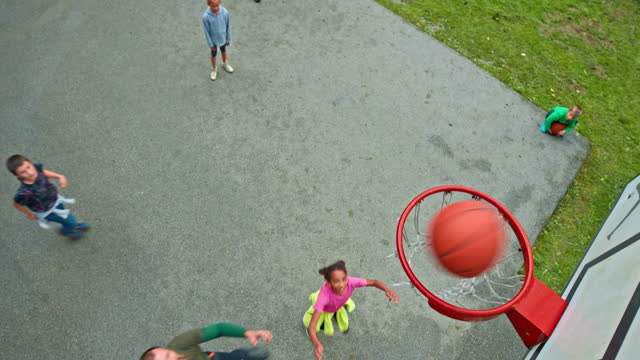 cs kids playing basketball with their fathers - sporting term stock videos & royalty-free footage