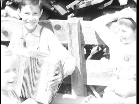 1937 b/w montage kids playing cards at sawmill, two women coming / tyrol, austria - austria stock videos & royalty-free footage