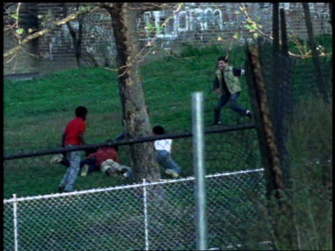 1982 WS Kids playing football / Bronx, New York City, New York, United States