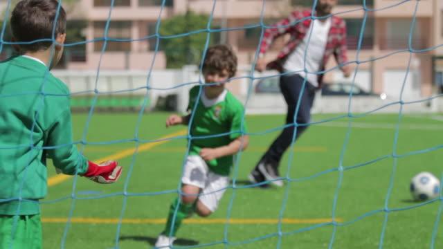 Kids playing football open shot