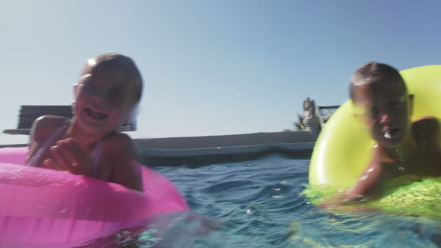 kids playing in a swimming pool - messing about stock videos & royalty-free footage