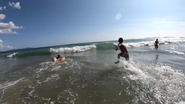 kids playing in sea waves in slow motion - children only stock videos & royalty-free footage