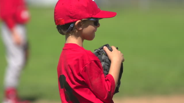 kids playing little league baseball. - slow motion - youth baseball and softball league stock videos and b-roll footage