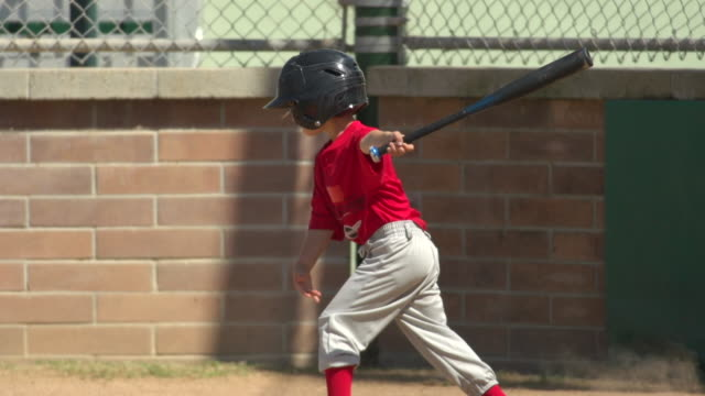 kids playing little league baseball. - slow motion - little league stock videos and b-roll footage