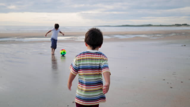 kids playing on the beach - northumberland coast stock videos & royalty-free footage