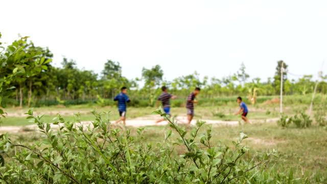 Kids playing soccer football.