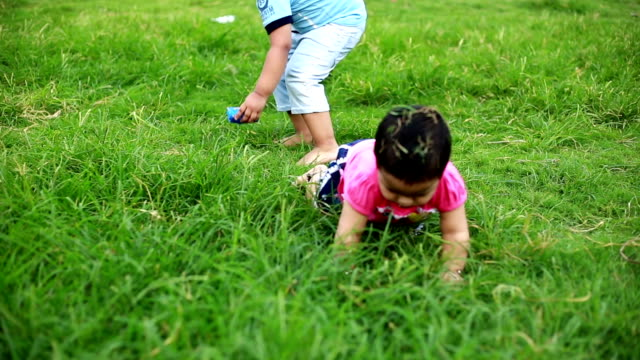 kids playing together in park - crawling stock videos & royalty-free footage
