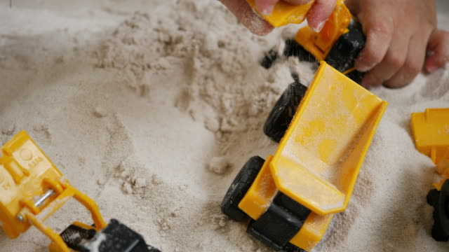 kids playing toy construction on sand - 2 kid in a sandbox stock videos and b-roll footage
